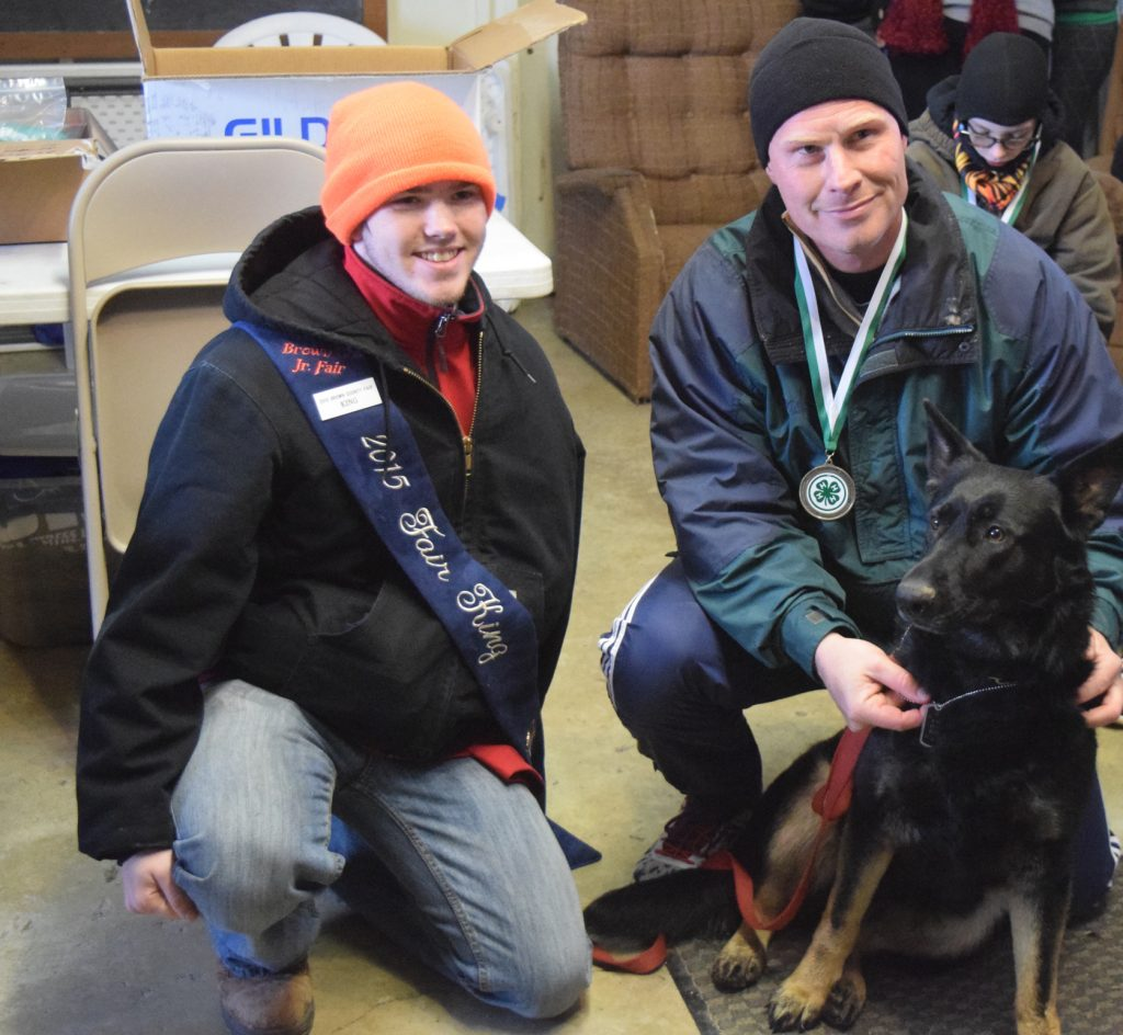 Rick Haney and his dog Aggie pose with Brown County Fair King Tristan Cahall after the Run Into 4-H 5K, held in Georgetown last month.