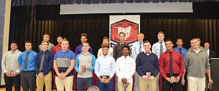 SBAAC American Division First Team football players pose with their awards during the Fall Sports Awards Dinner and Banquet held at Hamersville School on Nov. 9. Front row, from the left, are Zach Stacy (junior, Western Brown), Noah Hill (senior, Western Brown), Wyatt Fischer (junior, Western Brown), Steve Robbins (junior, Norwood), Matt Goodman (junior, Norwood), Isaiah Freeman (junior, Norwood), Toron Brown (junior, Norwood), Peyton Schweickart (senior, New Richmond), Nick Sanchez (senior, New Richmond), and Gage Kramer (senior, New Richmond); back row, Ethan Gundler (senior, New Richmond), Jacob Cyrus (senior, New Richmond), Josh Anderson (sophomore, New Richmond), Jordan Ulrey (senior, Goshen), Kamrin Tuerck (senior, Goshen), Sam Edwards (senior, Goshen), Jake Rose (senior, Amelia), Blake Boykin (senior, Amelia), and Eli Altherr (senior, Amelia). Not present at picture time was Ollohjowon Wellington (senior, Norwood).